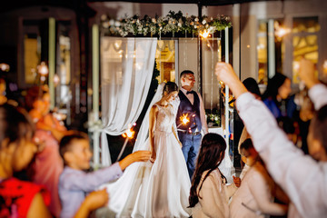 Wedding ceremony with bengal sparklers.