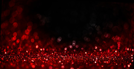 Abstract blur red glitter on black background. Card for Valentine's day, christmas and wedding...