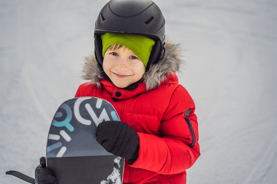 Little cute boy snowboarding. Activities for children in winter. Children's winter sport. Lifestyle