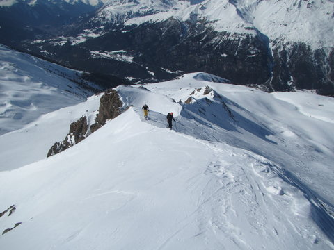 Ski touring, snowboarding and splitboarding in a Beautiful snowy winter mountain landscape in the Swiss alps