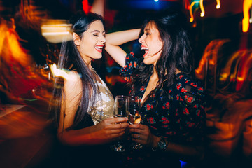 Two girls having fun at the club on New Year's party