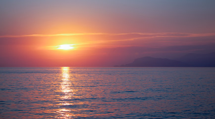 Wall Mural - Beautiful sunset, mountain and sea