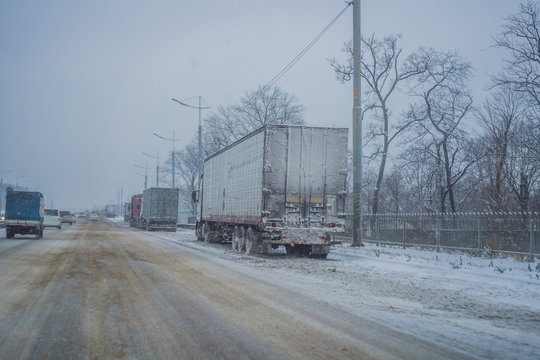 A lot of trucks that can not enter the city due to snowfall. Winter problems on the road