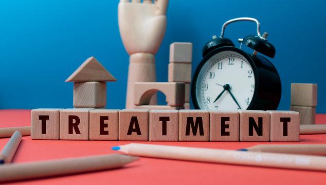 "Word ""Treatment"" written with wooden blocks"