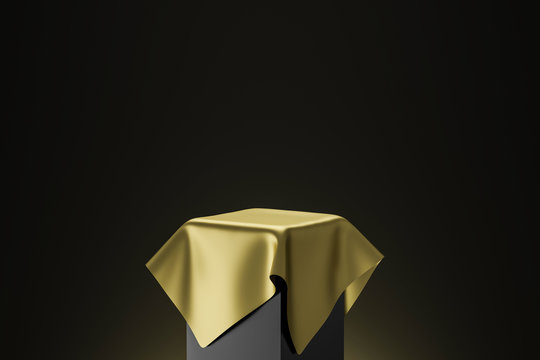 Gold pedestal or podium display with golden satin fabric platform concept on dark background. Blank shelf stand for showing product. 3D rendering.