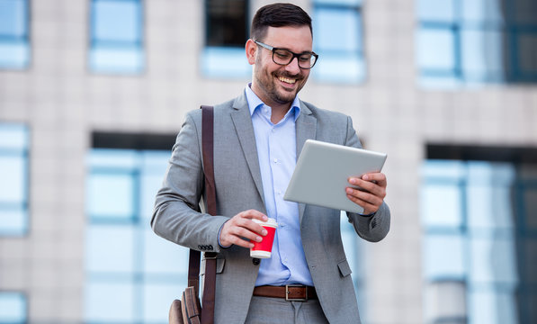 Businessman drinking coffee and checking notes with tablet. Business, lifestyle concept