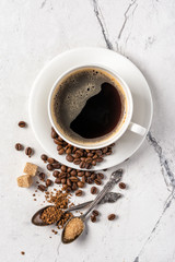 Morning black coffee with sugar in white cup