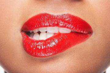 Woman Biting Red Lips