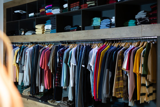 Assorted casual men clothes on shelves