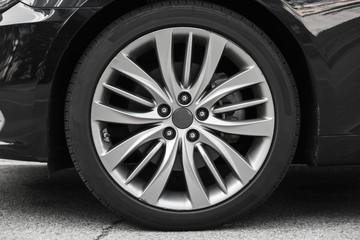 Modern luxury car wheel on a light alloy disc,