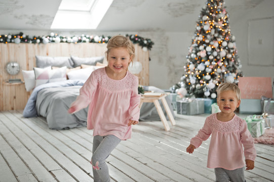 Little girls run around the Christmas decorated house 2065.