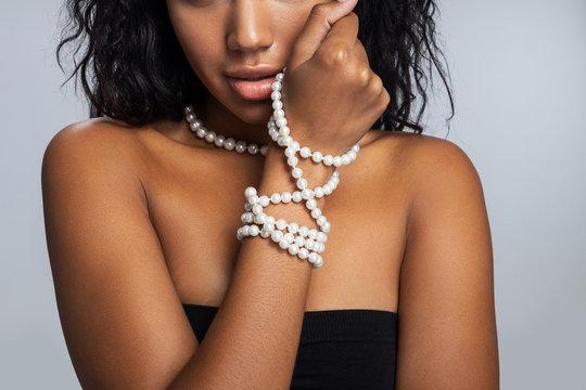 Afro American girl posing for camera in studio