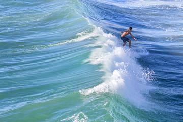 Man surfing in Huntington Beach, CA