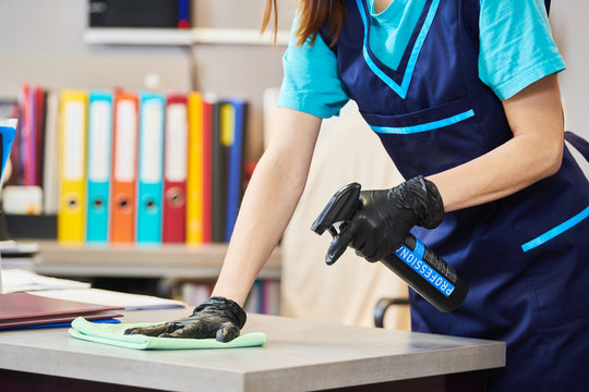 cleaning service. wiping office with cloth and liquid