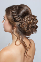 Papiers peints Salon de coiffure Portrait of a beautiful sensual light brown haired woman with a wedding hairstyle and nude make-up in a beauty salon. Wedding hairstyle.