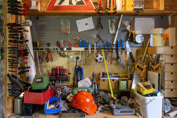 Mess and tools in disorder in a workroom. Equipment, home, interior, rope, dirty, house, messy, objects, stuff, box, chaos, clutter, cluttered