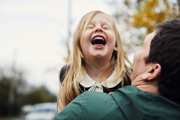 Father and child laughing together