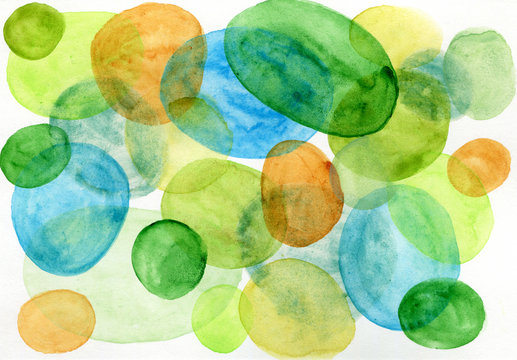 Bright watercolor spots on paper