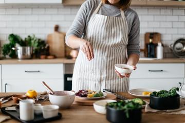 Cook preparing salad