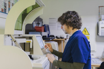 Doctor looking at monitor in laboratory