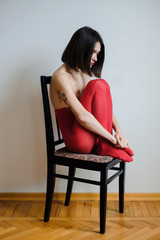 Abstract portrait of a young brunette woman on the chair