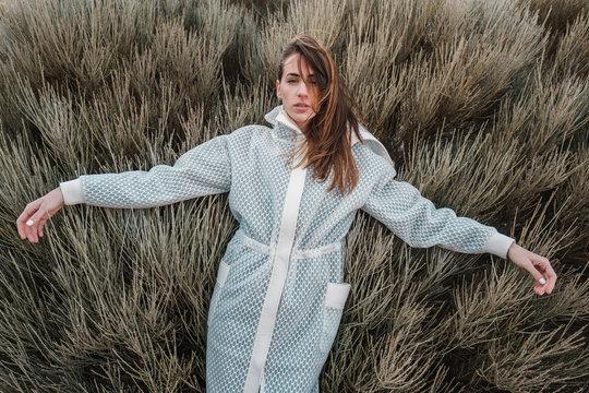 Fashion Model Wearing Futuristic White Coat
