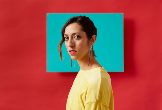 Portrait of a young woman in front of a colorful background