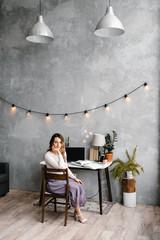 Pretty freelancer sitting near desk