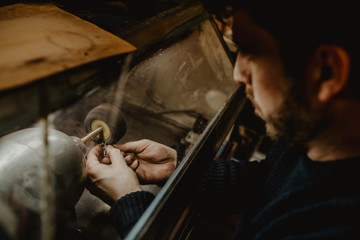 Crop hands polishing ring ornament