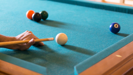 Man Playing Billiards In A Pool Table