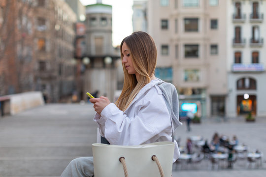 shopping girl talking by mobile