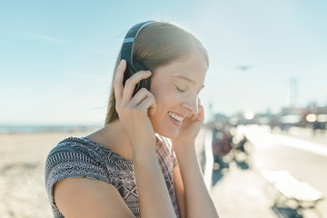 Young Beautiful Smiling White Woman Portrait With Black Headphones Listening Music. Lifestyle Stock Picture
