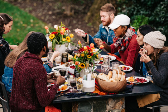 Group of friends enjoy fall dinner party