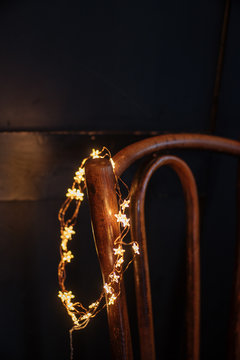 Fairy lights hanging on chair