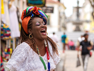Salvador da Bahia, Brazil, Happy Brazilian Woman of African Descent Dressed in Traditional Baiana Costumes Wall mural