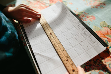 child makes week graph on graphing paper