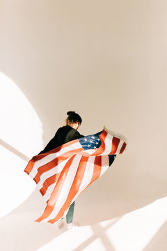 young asian woman with US flag