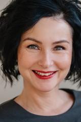 Headshot portrait of stylish mature happy woman