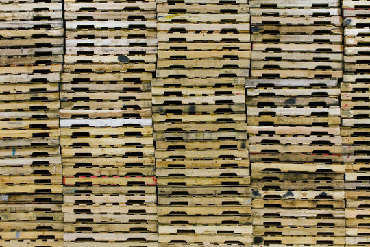 Wooden Pallets Stacked in Warehouse