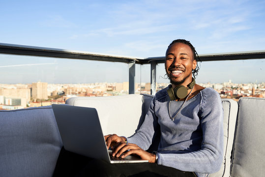 Cheerful freelancer working laptop.