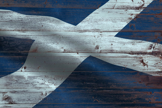 Scotland2 flag on an old wooden plank forming a background
