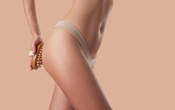 Woman make anti cellulite massage.. Perfect female buttocks with