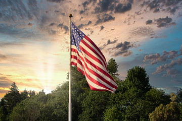 sunset and weather with cloudy sky behind american flag blowing in the wind Fotomurales