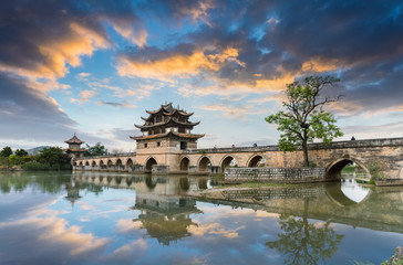 Wall Mural - yunnan double dragon bridge in sunset
