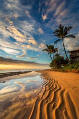 Kauai Beach Sunrise, ripples in the sand, reflection of an amazing sky and palm trees.