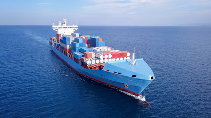 Fototapeta Large container ship at sea, loaded with various container brands. ULCV container ship sails on open water fully loaded with containers and cargo. obraz