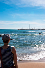 View of Atlantic ocean with a tourist. Cascais-Estoril, Portugal