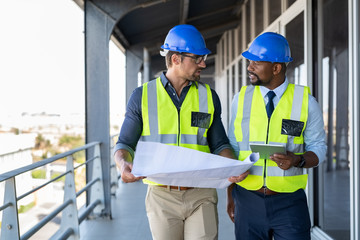 Architects discussing plan at construction site