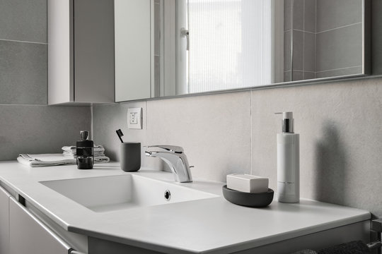 interior shot of a modern bathroom in foreground the integrated washbasin with faucet