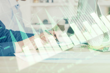 Photo sur Aluminium Pharmacie Forex graph with businessman working on computer in office on background. Concept of hardworking. Closeup. Multi exposure.